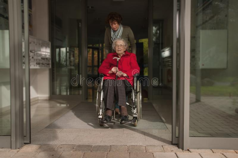 Young woman and senior woman going for shopping royalty free stock photo