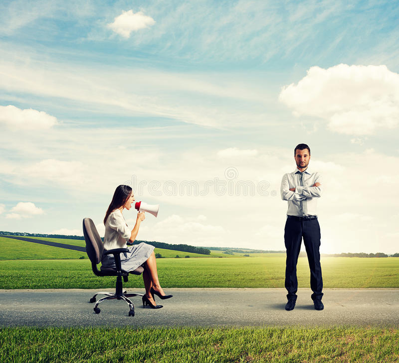 Young woman and serious calm man royalty free stock images