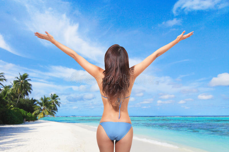 Young woman in bikini at the beach royalty free stock images