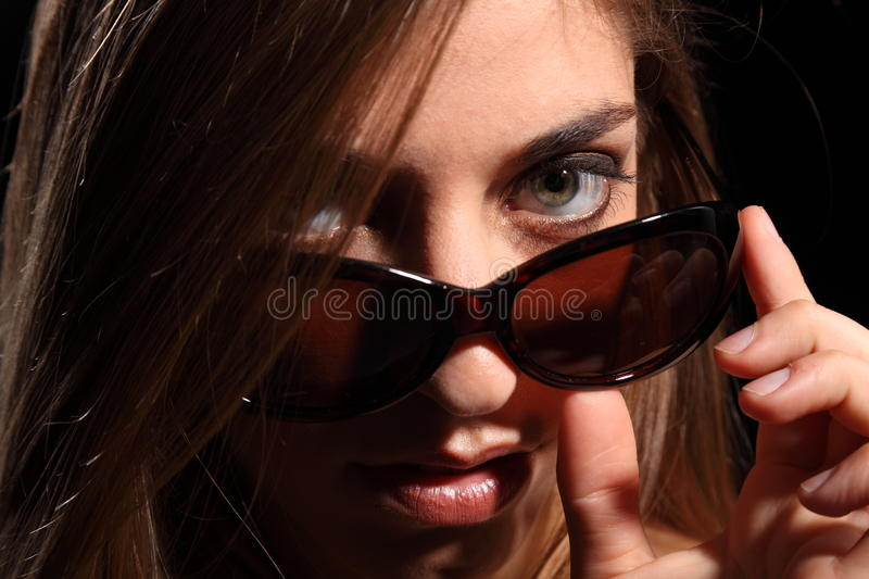 Young Woman With Look In Dark Sunglasses Stock Photos