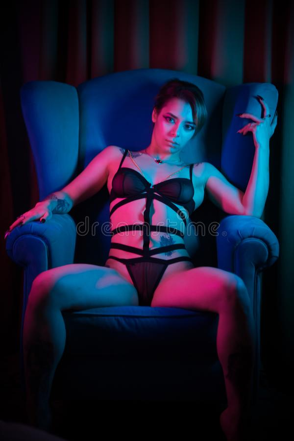 Girl stretching legs see through panties Young Woman In A Underwear Sitting In A Chair With Spread Legs Stock Photo Image Of Neon Female 155156052