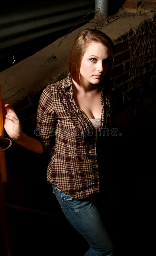 Young Woman In A Shadowy Alley Royalty Free Stock Photography