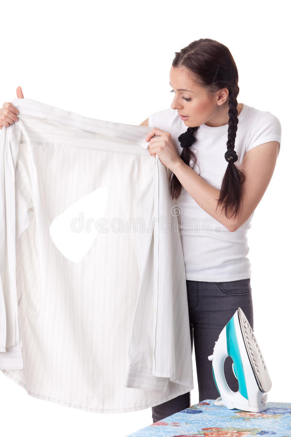 Young woman with shirt and iron. Young woman with shirt and iron on a white background. Housekeeping royalty free stock image