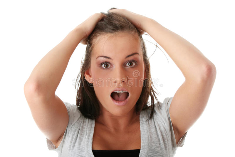 Young woman shocked stock image