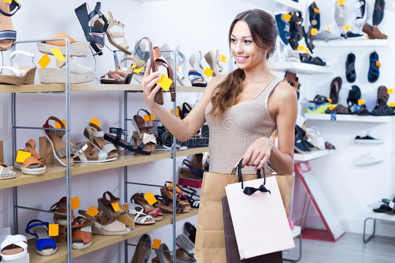 Young woman in shoes store stock photos