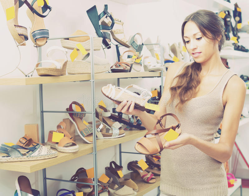 Young woman in shoes store royalty free stock image