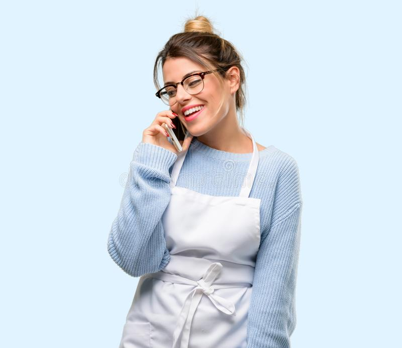Young shop owner woman wearing apron royalty free stock photos
