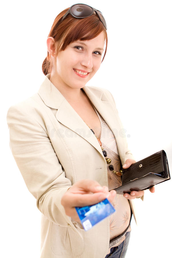 Young woman on shopping. Young brunette woman paying for shopping stock photo
