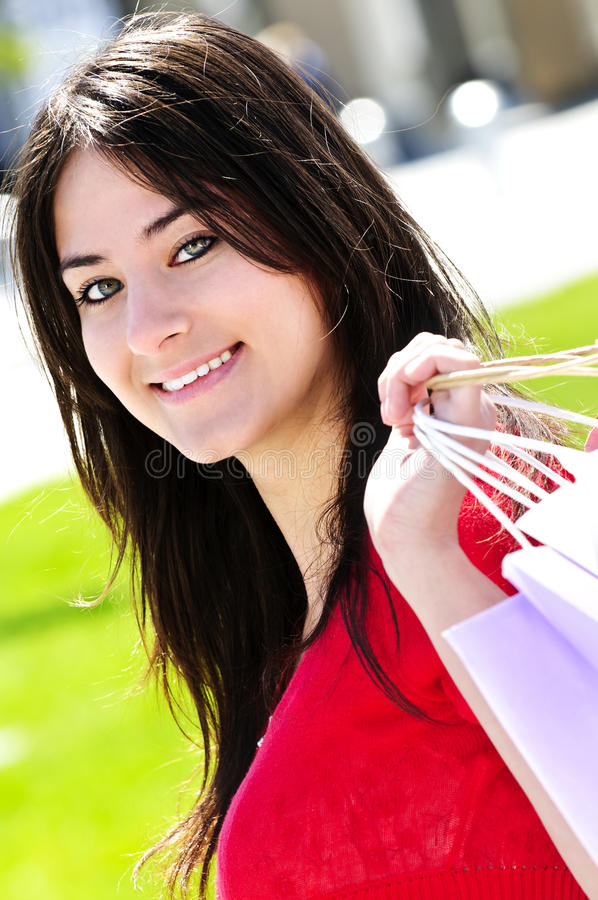 Download Young woman shopping stock photo. Image of attractive - 9818472