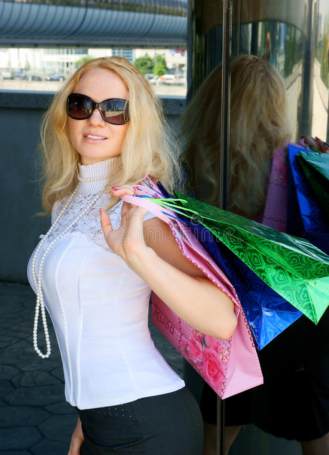 Download Young Woman With Shopping Bag Stock Photo - Image of blonde, emotion: 14441778