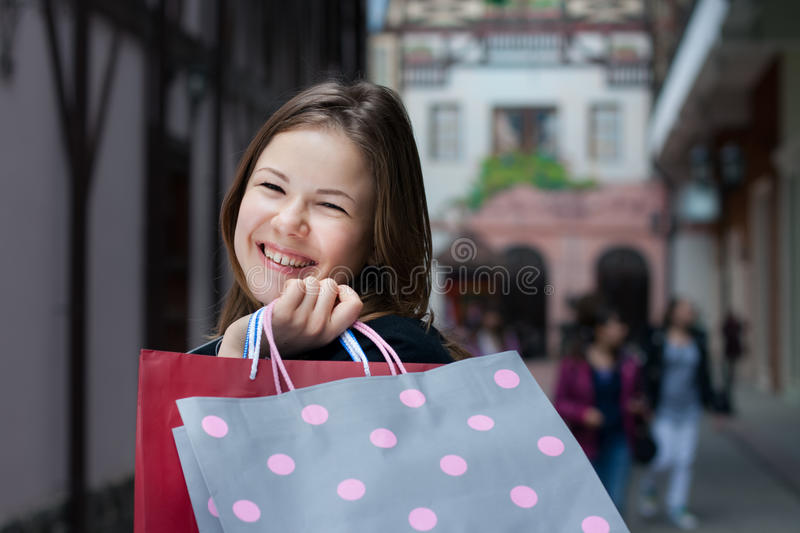 Young woman with shopping bags stock images