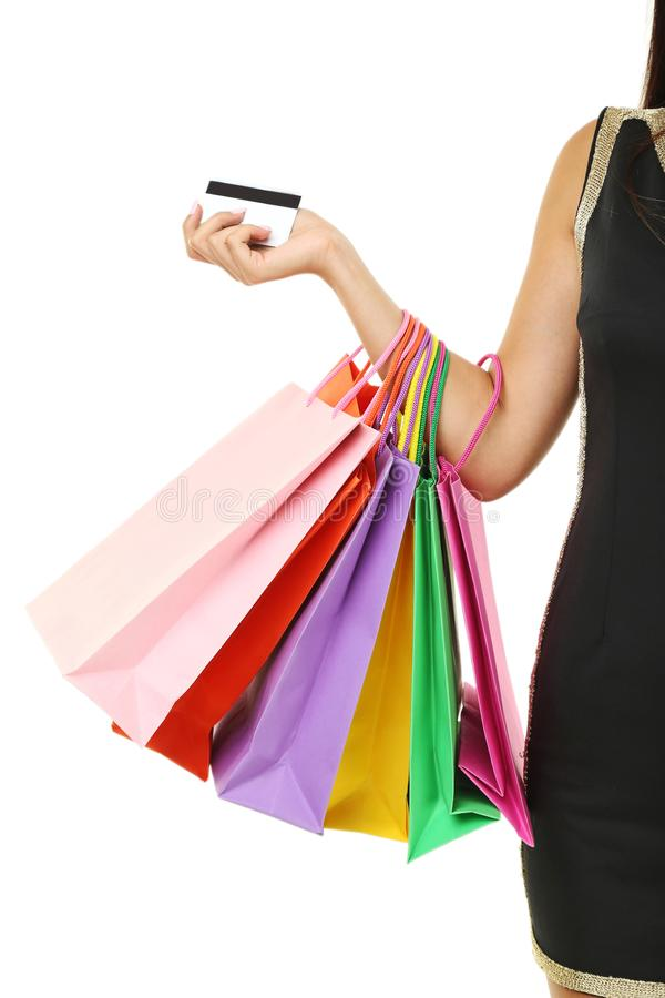 Woman with bags and credit card stock photo