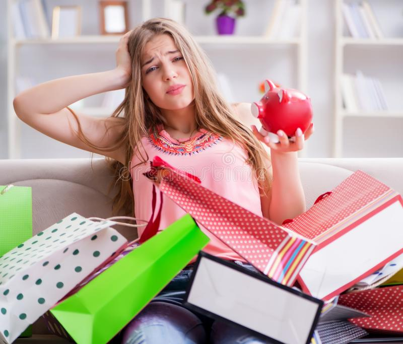 Young woman with shopping bags indoors home on sofa. The young woman with shopping bags indoors home on sofa royalty free stock photo