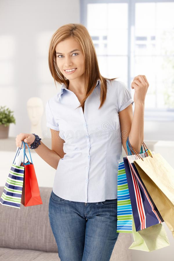 Young Woman With Shopping Bags Smiling Royalty Free Stock Photos