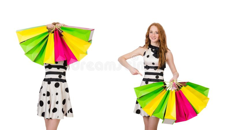 Young woman with shopping bags on white stock image