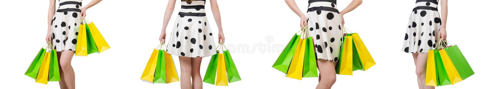 Young woman with shopping bags on white. The young woman with shopping bags on white royalty free stock photos