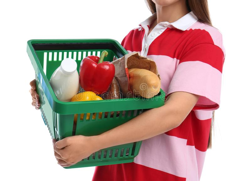Young woman with shopping basket on white royalty free stock image