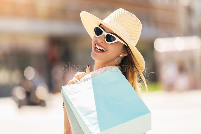 Woman in shopping. Happy woman with shopping bags enjoying in shopping stock images
