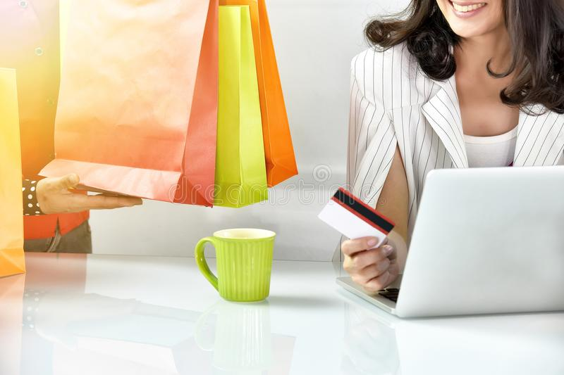 Young woman shopping online with credit card, Online ordering. royalty free stock images