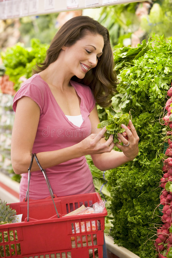 Young woman shopping for produce royalty free stock photos