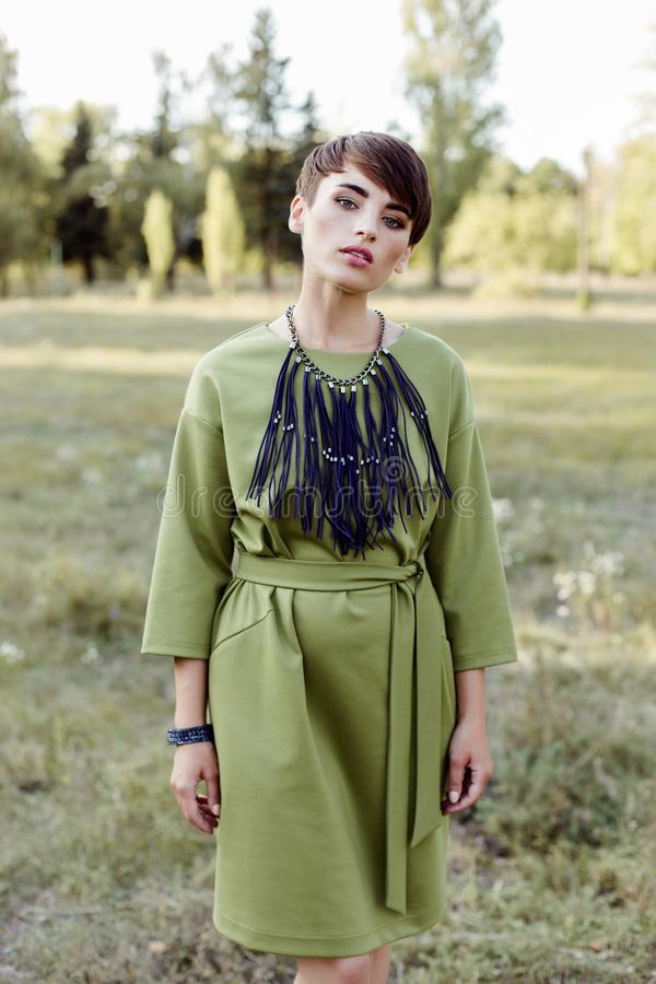 Young woman with short hair posing outdoors royalty free stock photo