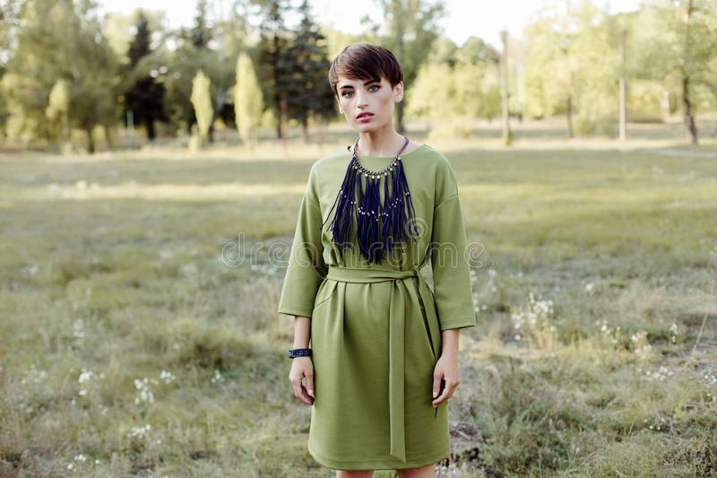Young woman with short hair posing outdoors royalty free stock photography