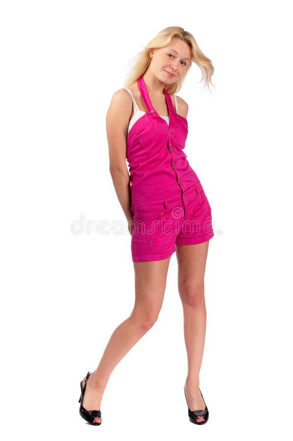 Young woman in short pink overalls stock photos