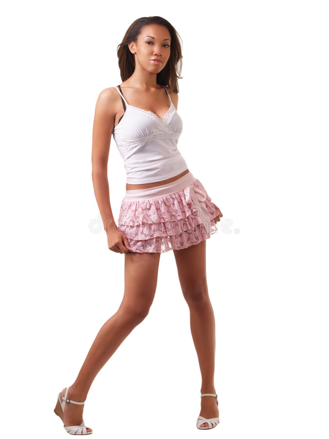 Young woman in short skirt and top