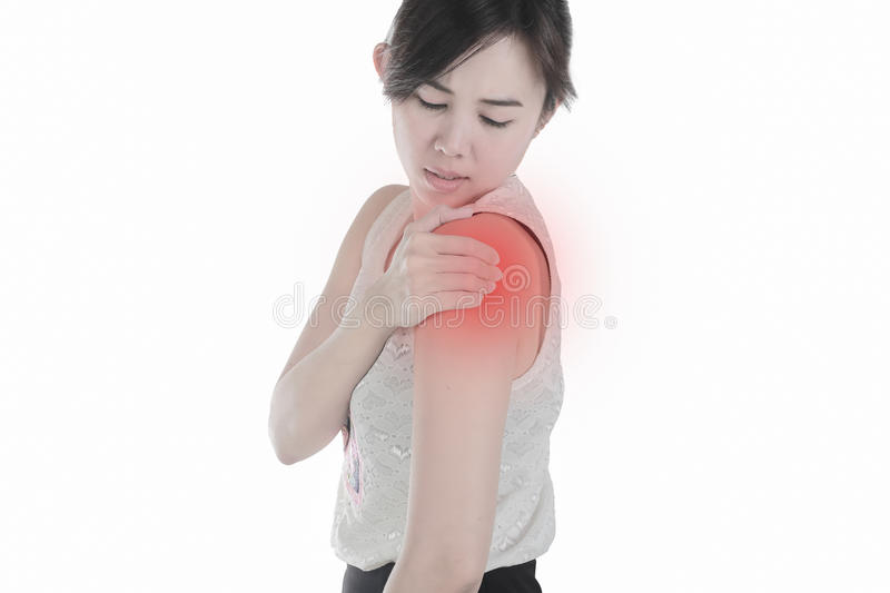 Young woman with shoulder pain isolated white background. royalty free stock images