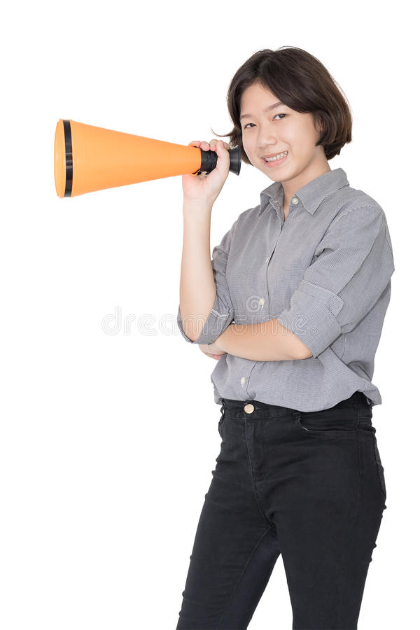 Young woman shouting for announce through a megaphone. Loud hailer, Cutout isolated on white background stock photos