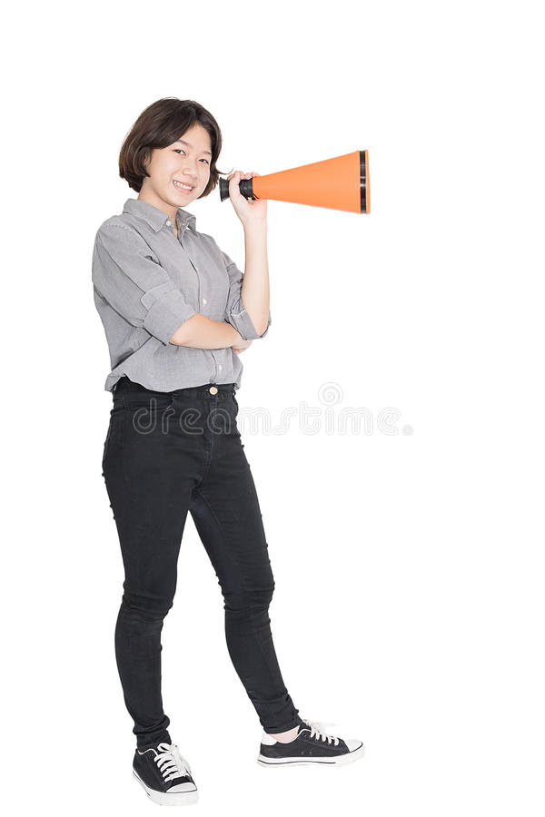 Young woman shouting for announce through a megaphone. Loud hailer, Cutout isolated on white background stock image