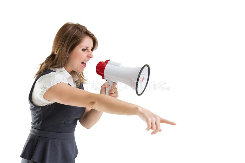 Young woman shouting into bullhorn as she gestures. Young woman shouting into bullhorn as she points over white background stock photography
