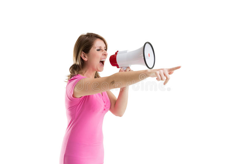 Young woman shouting into bullhorn as she gestures. Young woman shouting into bullhorn as she points over white background royalty free stock images