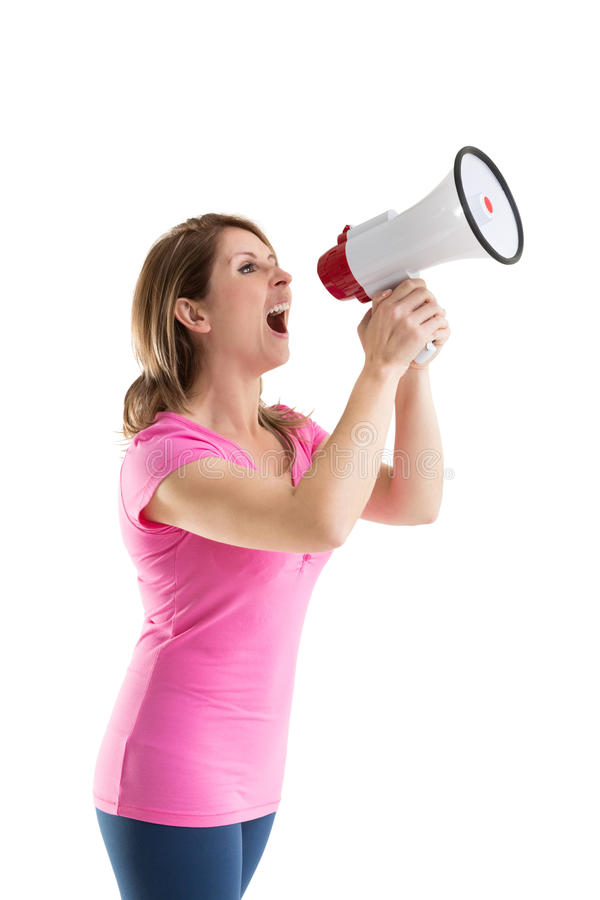 Young woman shouting into bullhorn. Over white background stock photo