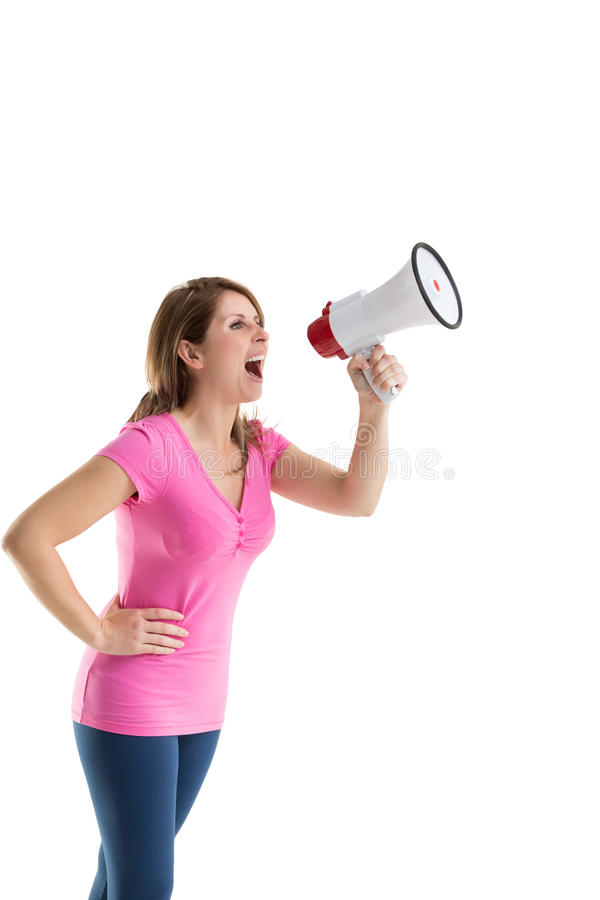 Young woman shouting into bullhorn. Over white background stock image