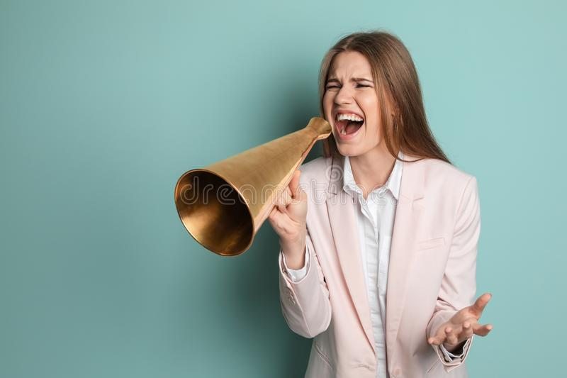 Young woman shouting into megaphone royalty free stock image