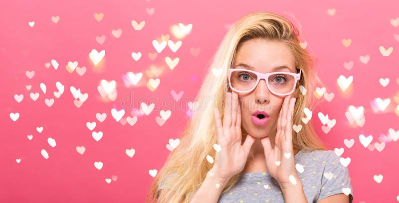Young woman shouting on a solid background stock photos