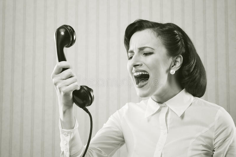Download Woman Shouting Into Telephone Stock Photo - Image: 29856620