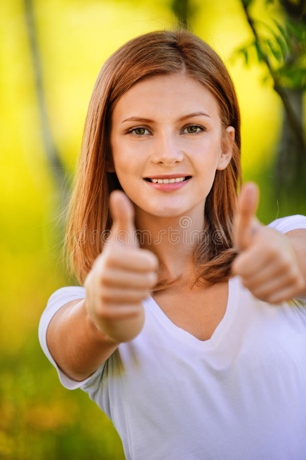 Young woman showing royalty free stock photos