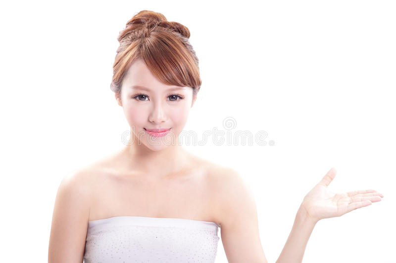 Download Young Woman Showing Beauty Product Royalty Free Stock Photo - Image: 33333845