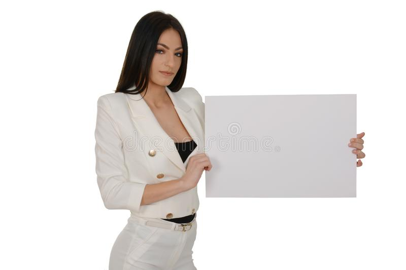Young woman showing blank signboard or copy-space for slogan or text, over white background royalty free stock photos