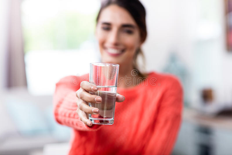 Download Young Woman Showing Drinking Glass With Water Stock Image - Image of refreshment, glass: 68154853