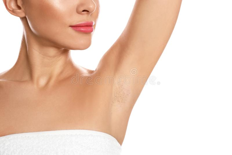 Young woman showing hairy armpit on background, closeup. Epilation procedure. Young woman showing hairy armpit on white background, closeup. Epilation procedure royalty free stock photography