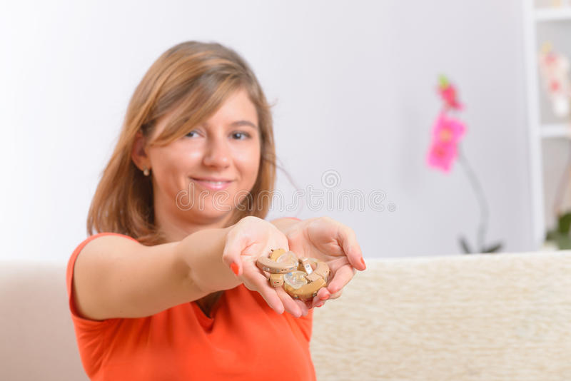 Young woman showing her deaf aids stock images
