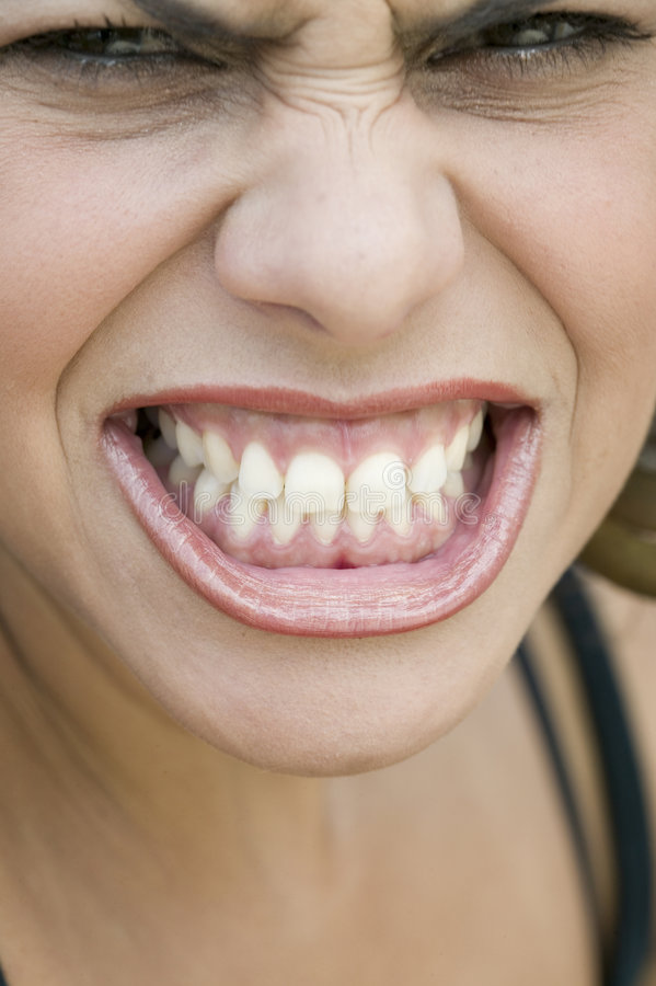 Download Young Woman Showing Her Teeth Stock Image - Image: 6328621