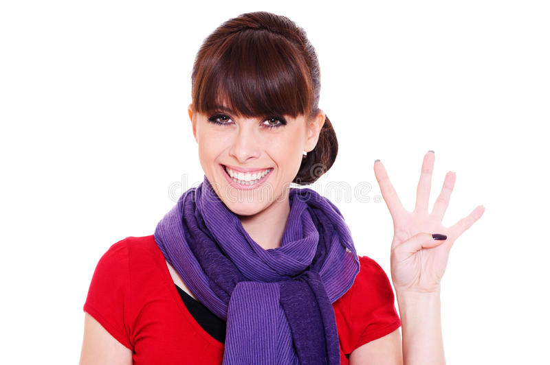 Young woman showing number four royalty free stock image