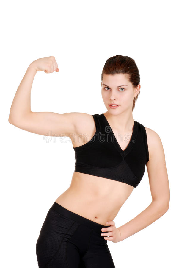 Young woman showing off muscles