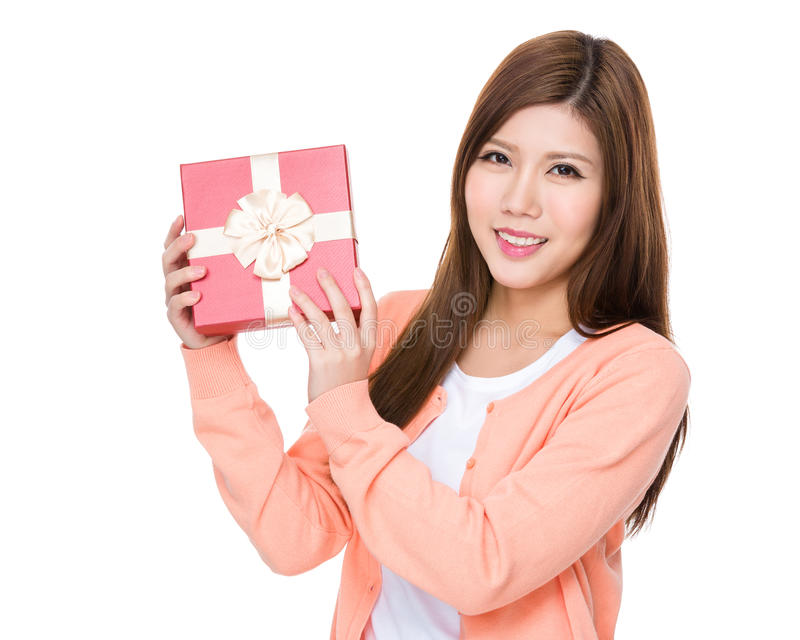 Young woman showing the red gift box. Isolated on white background royalty free stock photo