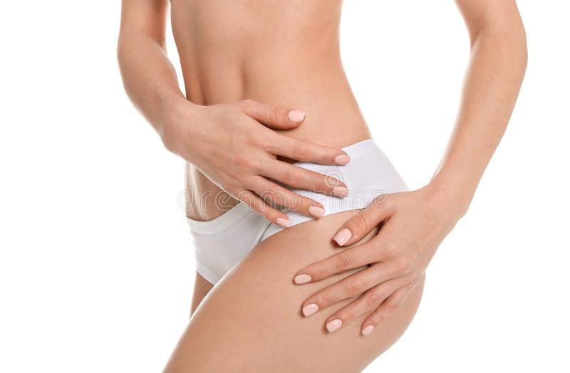 Young woman showing smooth silky skin after epilation. On white background royalty free stock photos