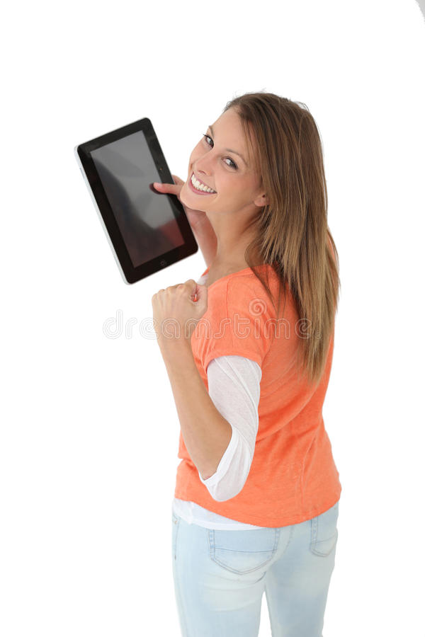 Young woman showing tablet's screen. Cheeerful girl showing digital tablet screen stock image